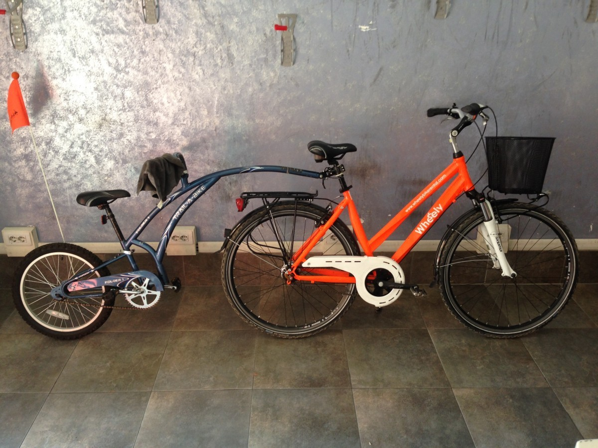 Trekking bike with tag-a-long tail